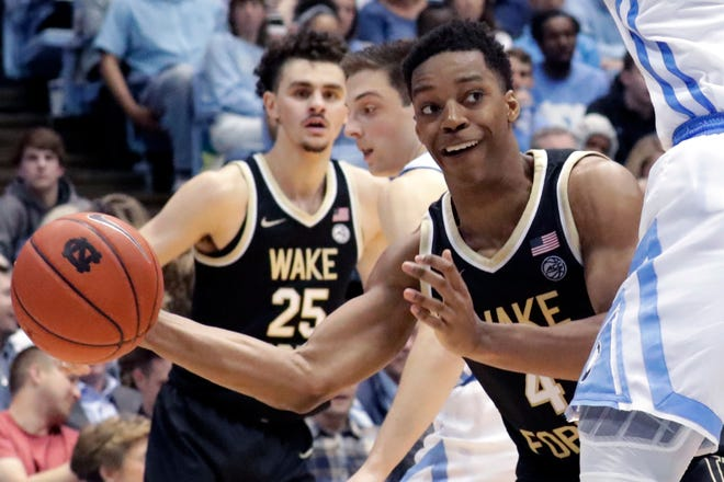 Wake Forest's Jahcobi Neath makes a pass, while teammate Ismael Massoud, rear, looks on in a game against North Carolina last season.