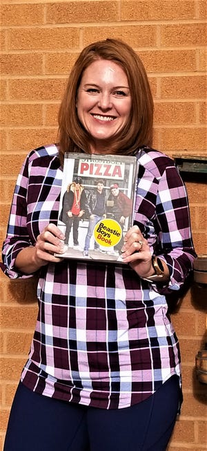 "Jennelle Chorak holding one of the greatest contributions to pop culture literature, the ""Beastie Boys Book."""