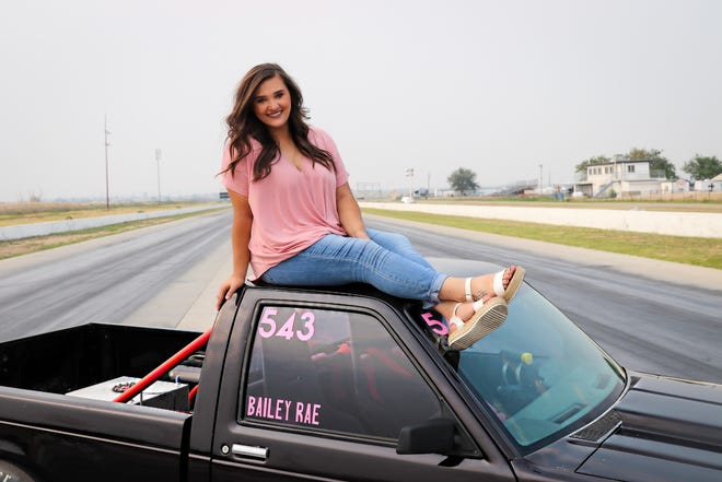 Bailey Ingo, who recently won a big race in Topeka, Kan., sits atop the truck that helped her claim victory. [Courtesy photo/Kriste Ingo]
