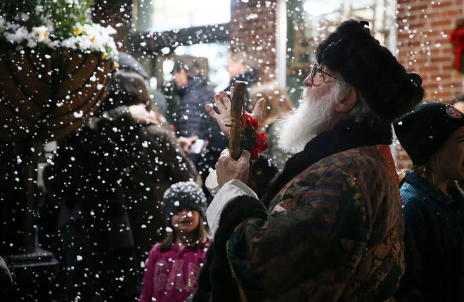 Santa Claus appears to have brought the snow to West Alabama during the Dickens Downtown celebration on Main Ave. in Northport Tuesday, Dec. 3, 2019. [Staff Photo/Gary Cosby Jr.]