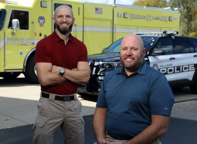 Corby LaCroix (left) and Brody Taphorn are the chaplains for the Hilliard Division of Police and the Norwich Township Fire Department, respectively. They are pictured Oct. 16 outside the Joint Safety Services Building in Hilliard.