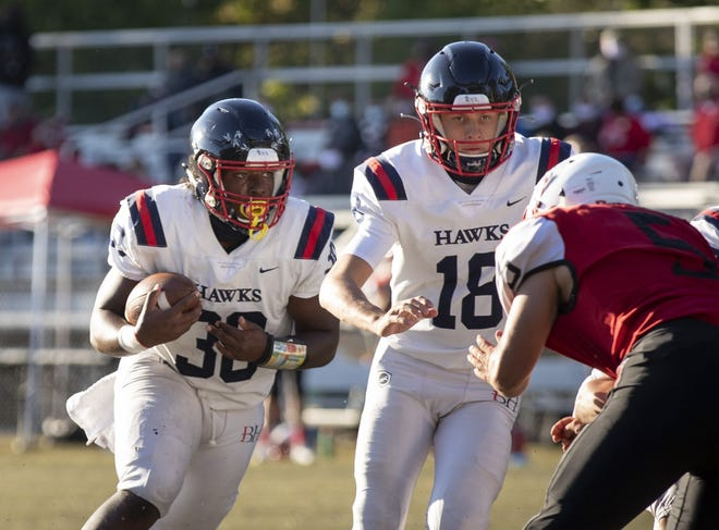 Marcelis Parker (30), Erik Underwood (18) and Hartley play host to Thornville Sheridan in a Division III, Region 11 semifinal Friday, Oct. 30.