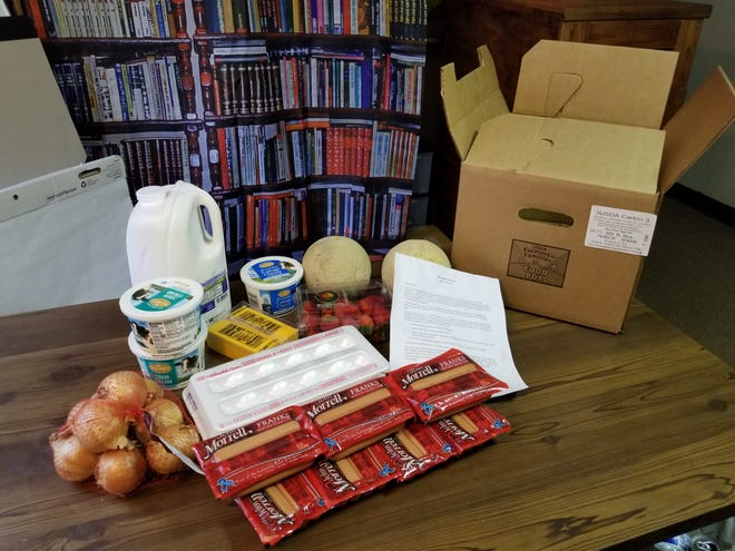 Carol Lemons's Farmers to Families Food Box, minus a package of grapes she said she threw away because they contained mold.