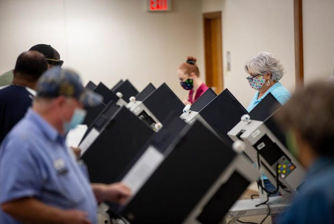 Voters cast their ballots during early voting at Taylor City Hall.