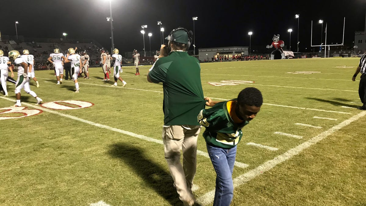 Sixth grader has hands full at Island Coast High football games 2
