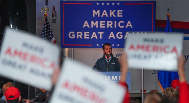 Donald Trump Jr., speaks a week before Election Day during a Make America Great Again event on Tuesday at Amerilux International in De Pere .