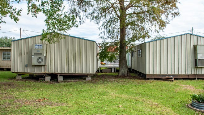 Portable buildings are seen at many Lafayette Parish schools, including Lafayette High, Tuesday, Oct. 27, 2020.