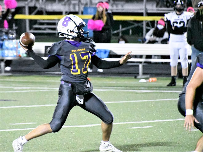 Bloom Carroll junior quarterback, KJ Benedict gets set   to throw a pass during the Bulldogs' 35-0 playoff win over Carrollton last week. Benedict passed for 226 yards and four touchdowns. The Bulldogs will travel to Licking Valley on Saturday.