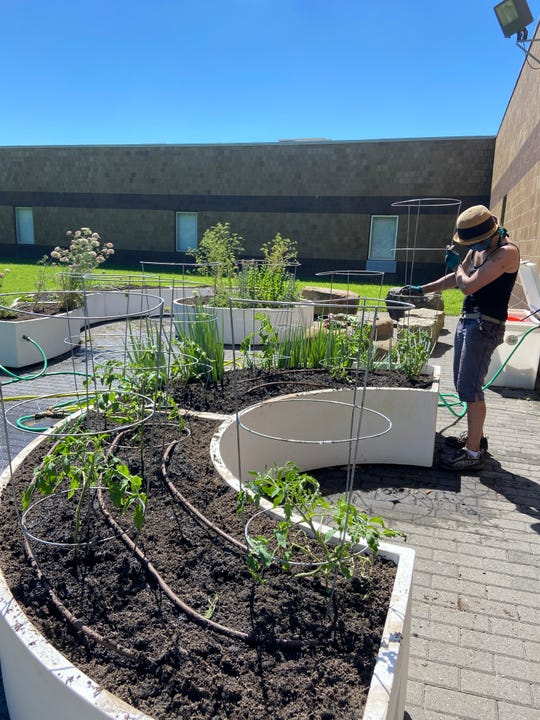 A Big Green program coordinator tends to the Big Green Learning Garden at Kirby Middle School this summer.