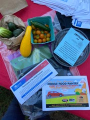 "Big Green partnered with Red Zone Ministries to hand out school supplies, fresh produce and ""Green at Home"" grow kits to Orange Mound students."
