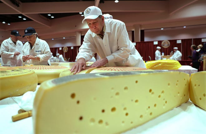 Christophe Megevand of Schuman Cheese in New Jersey judges the Rhined Swiss-style cheese category at the 2018 World Championship Cheese Contest in Madison. The 2021 contest has been pushed back to 2022 because of the coronavirus pandemic.