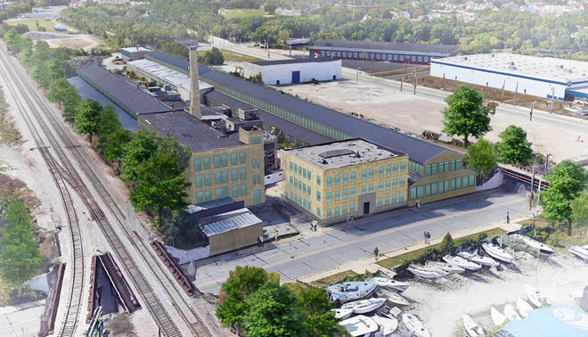 A group of historic industrial buildings in Milwaukee's Harbor District could be redeveloped into 311 apartments.