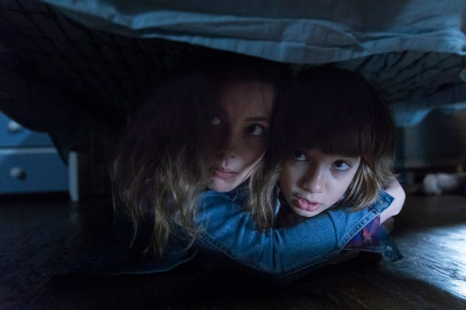 """Gillian Jacobs, left, and Azhy Robertson are a mother and son fleeing a truly killer app in """"Come Play."""""""