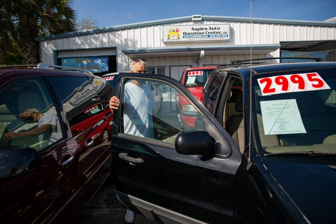 Naples Auto Donation Center Salesman Greg Mitchell talks talks about the 2007 Ford Escape at his dealership, Tuesday, Oct. 27, 2020,  in Naples.