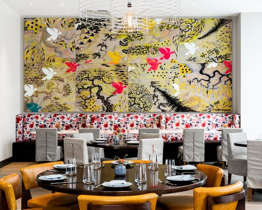 Modern art and striking patterns liven up the space at Allegory.