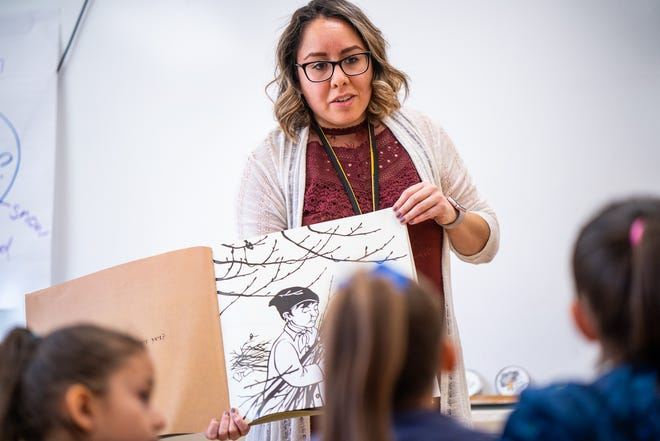 A teacher in training at Western New Mexico University, which recently earned an A+ for program diversity, interacts with area school children.