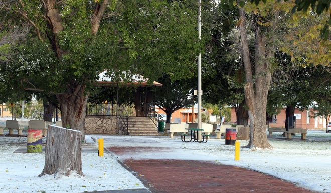Luna County Courthouse Park was blanketed by snow Tuesday as a winter storm swept through southern New Mexico.