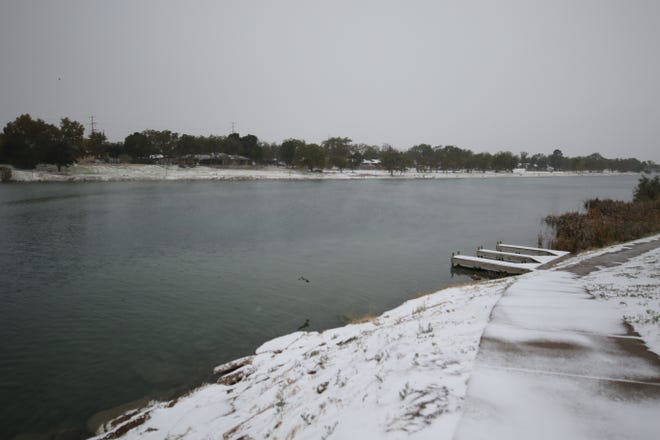 Snow falls along the banks of the Pecos River, Oct. 27, 2020 in Carlsbad.