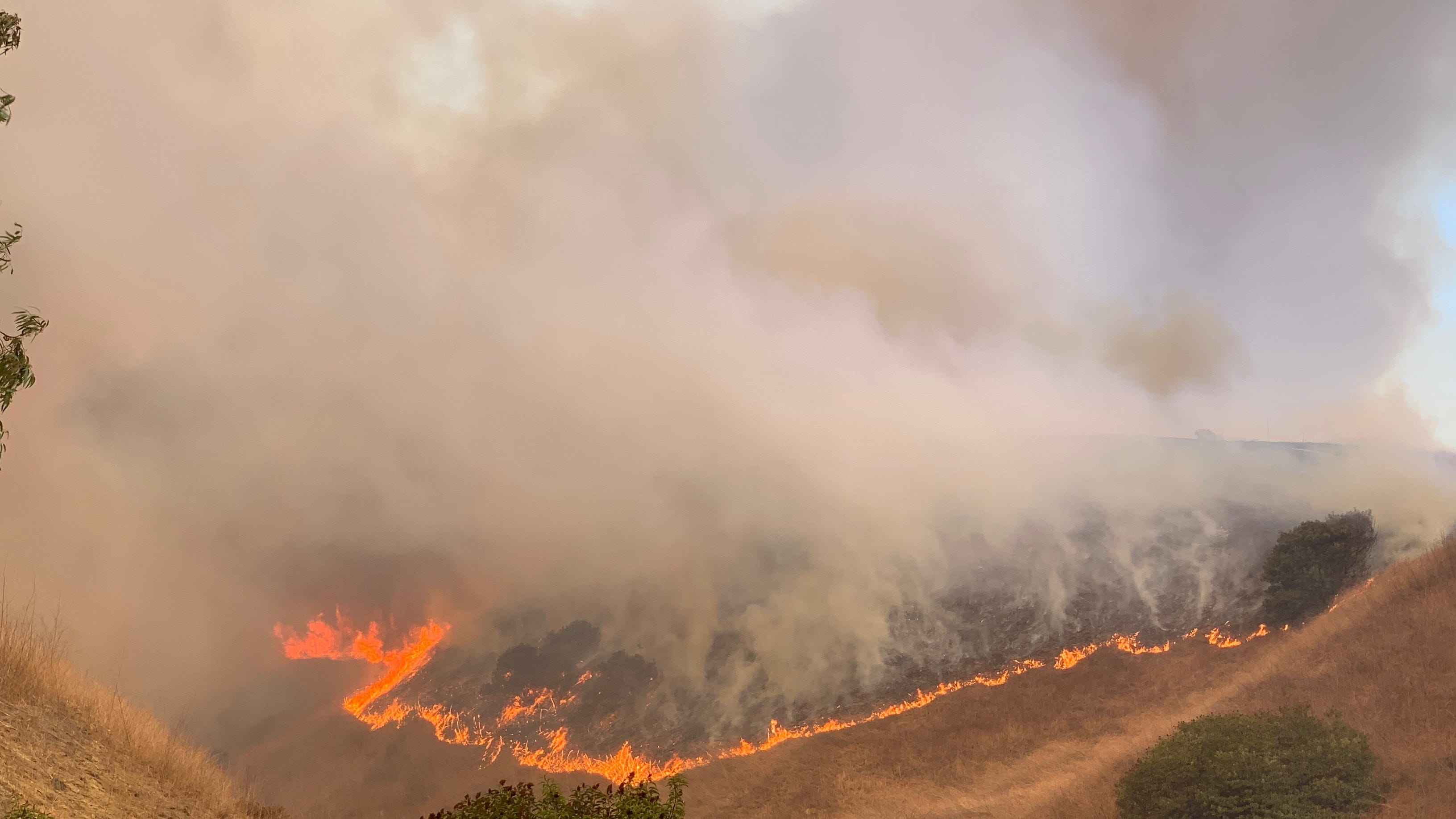 More than 14,000 acres burned; evacuations lifted
