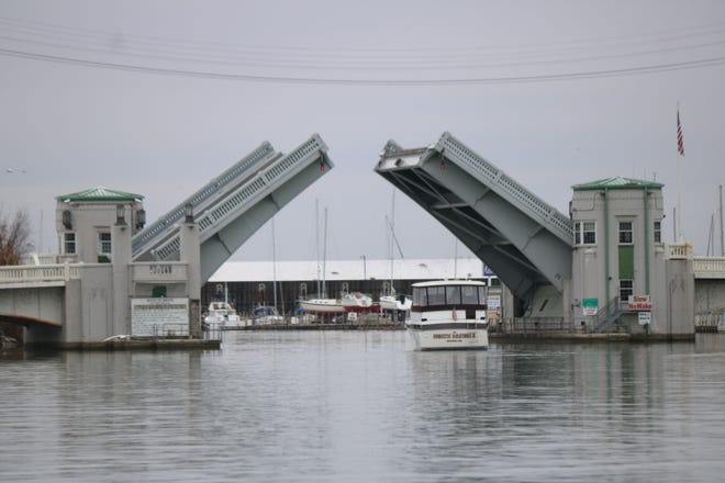 """The """"Domestic Relations II,"""" out of Dayton, heads under the Port Clinton Lift Bridge on the Portage River on Tuesday."""