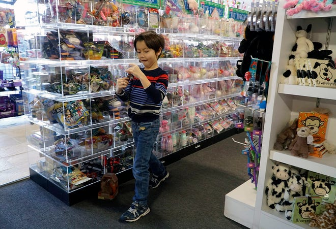 In this file photo,  child looks at toys while Christmas shopping with his family at Toy Maven in Dallas on Tuesday, Dec. 24, 2019. As a result of  the pandemic recession, this Christmas will be one of tight budgets and difficulty putting food on the table for many families. (Lawrence Jenkins/Dallas Morning News/TNS)