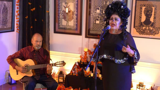 A Day of the Dead performance by Uriel Mendoza, Guitarist and Jovita Molina, Singer.