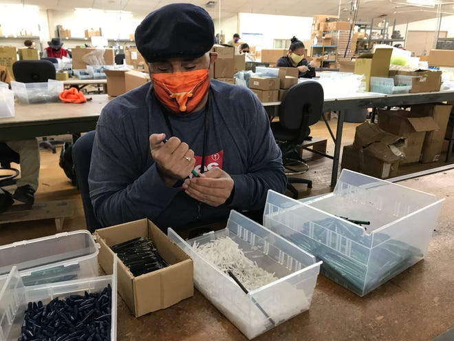 Eric Lopez builds biodegradable pens made from cornstarch at the West Texas Lighthouse for the Blind, 2001 Austin St.,  on Monday, Oct. 26, 2020.