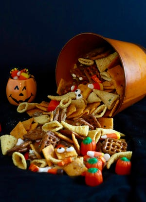 Monster Munch Halloween Snack Mix may become a new fun Halloween tradition and is so easy even your kids can make it.