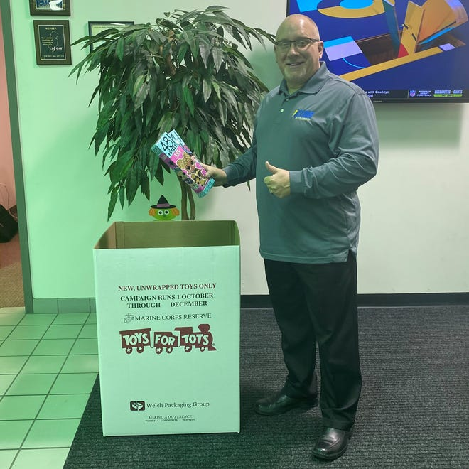 Rich Datello, one of the owners of Action Hyundai of Millville, adds a donation to the Toys for Tots for Cumberland County donation box at the dealership. Action Hyundai has stepped in to sponsor the Cumberland County Toys for Tots effort this year. Donations will be accepted through Dec. 5 at the dealership and at other businesses throughout the county.