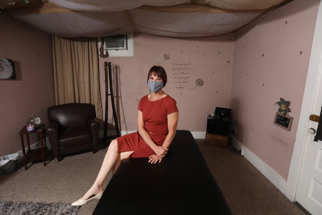 Mandi Weiser is a licensed massage therapist in Zanesville. She is still trying to rebuild her business after being closed due to the state order earlier this year.