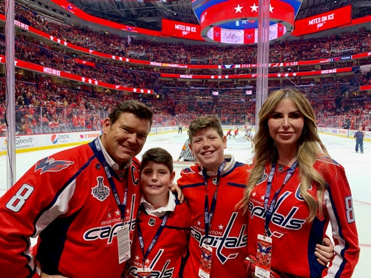 The Baiers: Bret, Daniel, Paul and Amy root on their home team at a Washington Capitals hockey game.