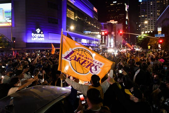 Fans gather in downtown Los Angeles after the Lakers won the championship over the Miami Heat on Oct. 11.