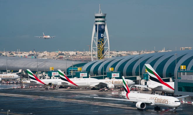 In this Dec. 11, 2019 photo, an Emirates jetliner comes in for landing at Dubai International Airport in Dubai, United Arab Emirates. The airport is getting busier but it's a long way from what it once was amid the coronavirus pandemic. To boost those numbers, airport CEO Paul Griffiths is urging countries to move away from mandatory quarantines on arriving passengers and toward the strategy embraced by Dubai. That includes aggressive coronavirus testing before departure, followed by mandatory mask-wearing on aircraft.