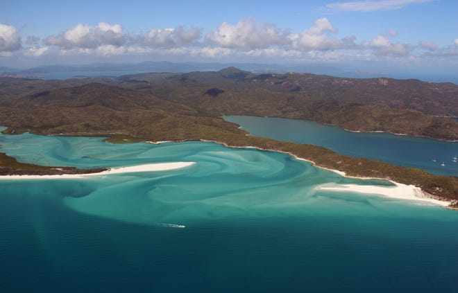 This file photo taken on November 20, 2014, shows an aerial view of the Great Barrier Reef off the coast of the Whitsunday Islands, along the central coast of Queensland.