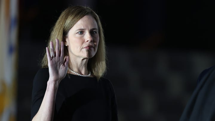 WASHINGTON, DC - OCTOBER 26: U.S. Supreme Court Associate Justice Amy Coney Barrett is sworn in by Supreme Court Associate Justice Clarence Thomas during a ceremonial swearing-in event on the South Lawn of the White House October 26, 2020 in Washington, DC. The Senate confirmed Barrett's nomination to the Supreme Court today by a vote of 52-48. (Photo by Tasos Katopodis/Getty Images) ORG XMIT: 775581559 ORIG FILE ID: 1282403009