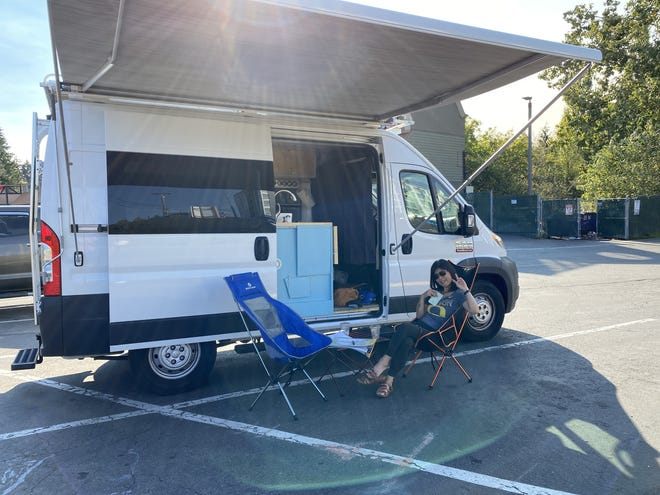 Andrew Funderburg's van that he's taken on the road to meet with clients. Pictured: wife Ikuyo Funderburg