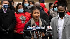 """Flanked by family members and attorneys, Sasha Williams talks about her sister, Tafara Williams, during a press conference outside city hall in Waukegan, Ill., Tuesday, Oct. 27, 2020. Williams, 20, was wounded and her boyfriend, 19-year-old Marcellis Stinnette, was killed when they were both shot by a Waukegan police officer on Oct. 20. Three days after the incident, Waukegan Police Chief Wayne Walles announced that he had fired the officer, saying he'd committed """"multiple policies and procedure violations."""" (Ashlee Rezin Garcia/Chicago Sun-Times via AP)"""