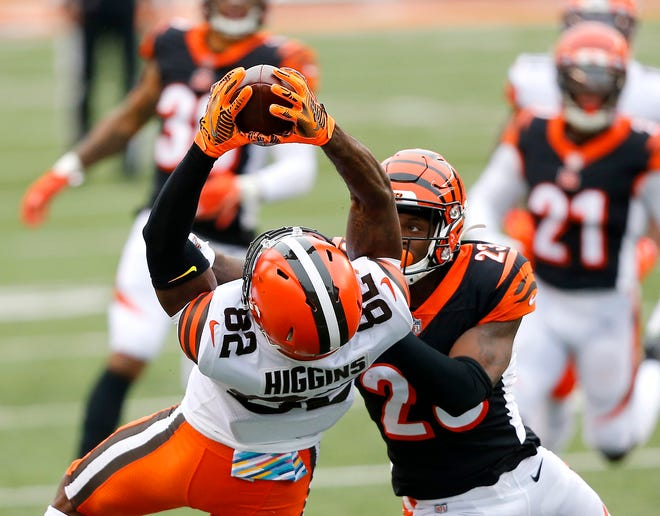 Browns wide receiver Rashard Higgins makes a circus catch over Bengals cornerback Darius Phillips late in their Week 7 game in Cleveland.