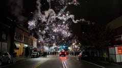 Fireworks explode in the sky during a protest in response to the police shooting of Walter Wallace Jr., early Tuesday.