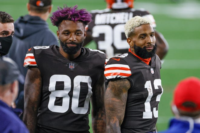 Cleveland Browns wide receivers Jarvis Landry (80) and Odell Beckham Jr. (13) stand on the sideline during the first half of an NFL football game against the Cincinnati Bengals, Thursday, Sept. 17, 2020, in Cleveland.