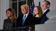 From left, first lady Melania Trump, President Donald Trump, Amy Coney Barrett and Jesse Barrett, stand on the Blue Room Balcony after Supreme Court Justice Clarence Thomas administered the Constitutional Oath on the South Lawn of the White House in Washington on Monday.
