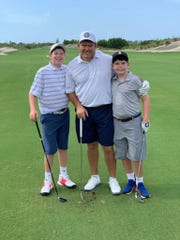 Bret Baier with his sons, Paul, far left, and Daniel, on the golf course.