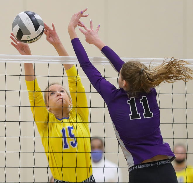 Coventry's Ronnie Meinen, facing, blocks the shot by Triway's Chloe Sherrib during the first set of a Division II district volleyball match last week. ,