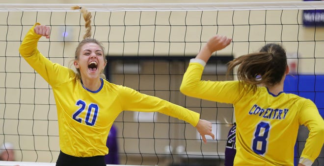 Coventry's Carly Wightman, facing, celebrates as the Comets win in three straight sets against Triway in a Division II district volleyball match, Wednesday, Oct. 28, 2020, in Coventry, Ohio. [Jeff Lange/Beacon Journal]