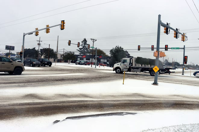 Vehicles travel through the inclement winter weather Tuesday. The city of Amarillo recently hosted a news conference, outlining how officials clear and treat roads during this kind of weather.