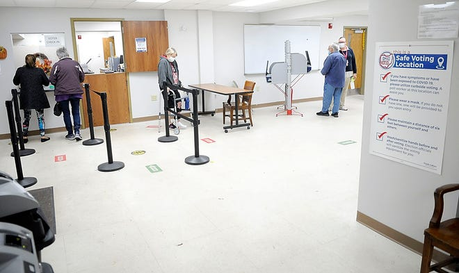 Voters check in at the Ashland County Board of Elections and cast their ballots during early voting on Wednesday, Oct. 28, 2020. TOM E. PUSKAR/TIMES-GAZETTE.COM