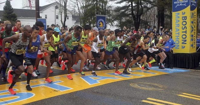 Runners like these at the start of the 123rd Boston Marathon in 2019 didn't get to compete here in April 2020 and won't be able to again in April 2021 due to the pandemic