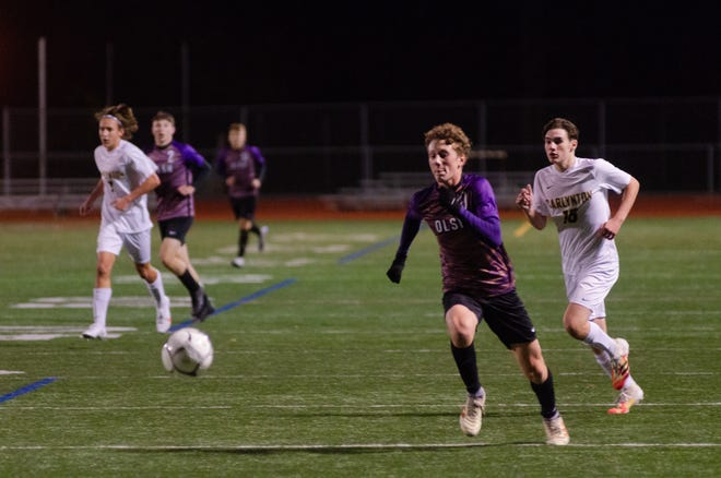 OLSH's Bryan Kaminski races for the ball during the Chargers' WPIAL Class 1A playoff game Tuesday night at Peters Township High School.