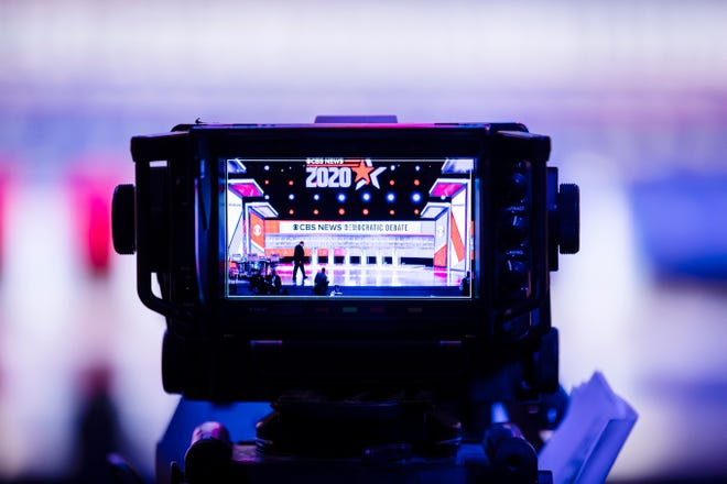 In this Feb. 25, 2020 file photo, the monitor of a television camera shows the set stage for a Democratic presidential primary debate, in Charleston, South Carolina. The event was part of the long road for media to Tuesday's election night.