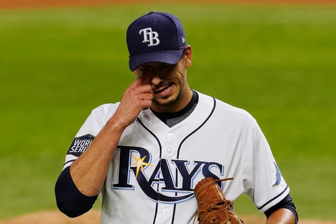 Tampa Bay Rays starting pitcher Charlie Morton reacts after giving up two runs against the Los Angeles Dodgers during the third inning in Game 3 of the World Series Friday in Arlington, Texas. [Tony Gutierrez/The Associated Press file]